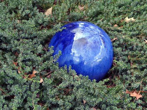 Flaming blue gazing blue sphere in the garden