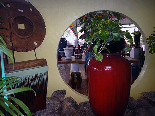 Bright colors with indoor plants and some wood element.